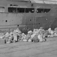 Japanese possessions await loading for repatriation,…