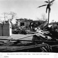 Damage to village houses. (N-1886a.19).