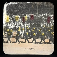 Parade or procession with men in uniform carrying red…