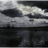 Sailboats on sandbar[?] in harbor [?]