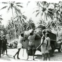 Guadalcanal natives load mail for United States Marines…