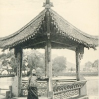 A Chinese Man Standing at a Pagoda, West Lake, Hangzhou