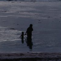 Adult and Child in the Ocean