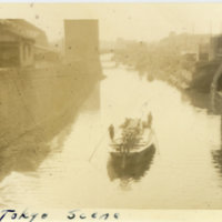 Two people rowing a wooden boat on the river, Tokyo…