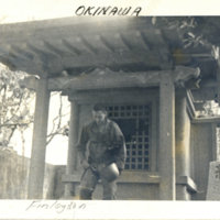 An American soldier (Finlayson) at a shrine in Okinawa