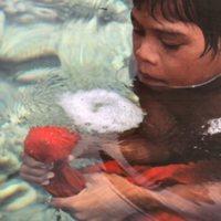 Boy Making Bubbles in Water