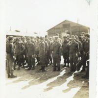 Kaizawa 2-005: American soldiers line up at U.S. Base,…