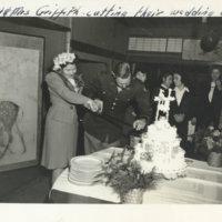 Captain & Mrs. Griffith cutting their wedding cake,…