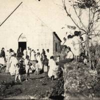 Native population in front of the Catholic Mission in…