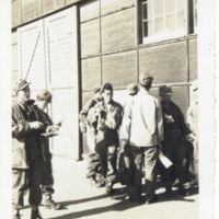 Kaizawa 2-003: American soldiers standing and reading…