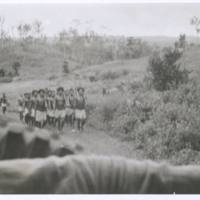Native hill boys returning from rubber plantations.…