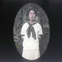 Young girl in sailor-style school uniform
