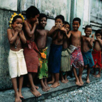 Ten Young Children Outside Building