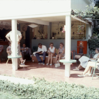 People hanging out in a backyard patio