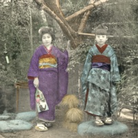 [One woman and a girl in kimono standing in  the…