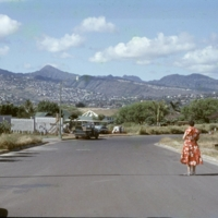 Woman standing on a road