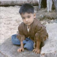 Little boy sitting at a beach