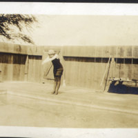 Woman Standing Beside Pool Getting Ready to Dive