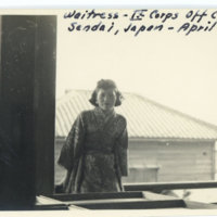 A waitress posing at the window of the IX Corps…