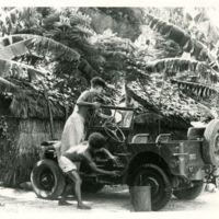 Natives washing a Navy jeep at Port Moresby, 1943