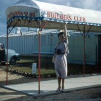 Woman in front of the Builder's Club. 26 Dec. 1949