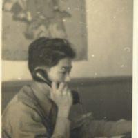 Kaizawa 3-025: Stanley Kaizawa answering the phone at…