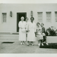 [118] Five Women in front of building entry