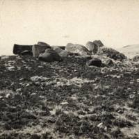 [Unidentified, possibly toppled statues of Ahu Vinapu]