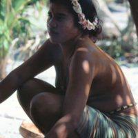 Young Woman Kneeling on Gravel