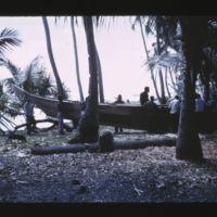 Ujelang men gathered around Lorenji's canoe just before…
