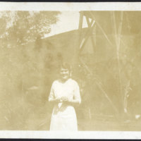 Woman Standing in Front of a Water Tower
