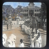 Parade exiting front of Iolani Palace Grounds, women…