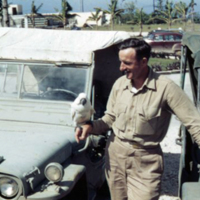 George Taggart & cockatoo. ComMar. Guam. Feb 1950
