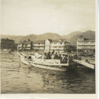 Japanese people on a small wooden boat, Kyushu Japan