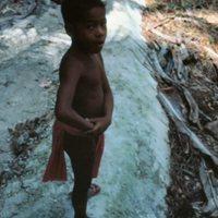 Boy Standing on Mound