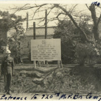 Sign at the entrance to 720th M.P. Battalion Camp,…