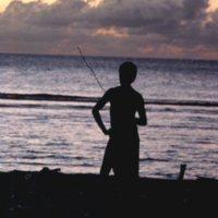 Young Man At Ocean During Sunset